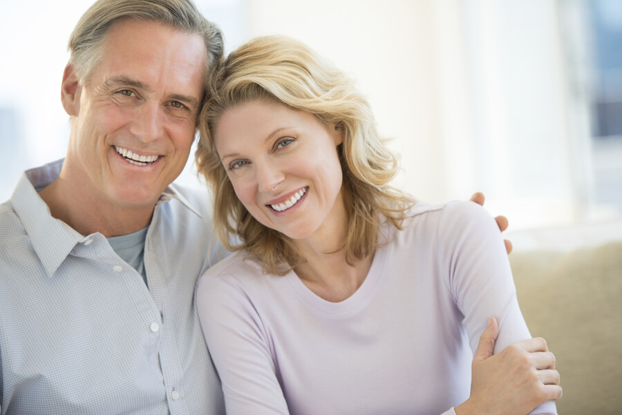 Mature couple smiling together at home